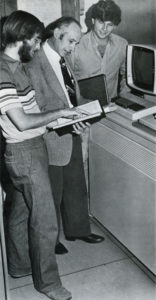 Professor Donald McIntyre and two students with the new IBM 4331 in 1980